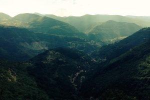 Zasele, in Bulgaira. High, dark green hills with mist near the summits.