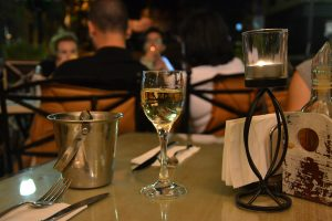 A glass of Bulgarian Rakia on a candle-lit dinner table in a restaurant