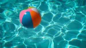 beachball being thrown into pool