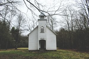A small, white church in rural America - somewhere in a forest