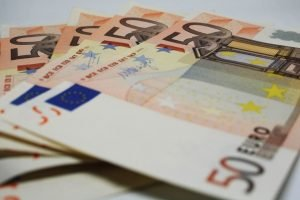 Italian euros fanned out on table