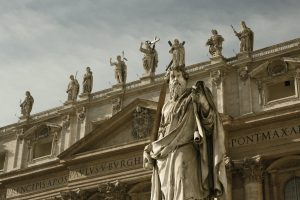 Religious statues on a carved stone building in the Vatican