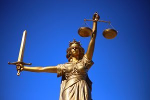 A statue of Lady Justice - blindfolded, scales in one hand and sword in the other