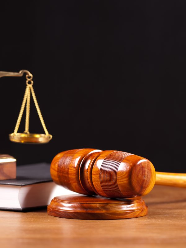 scales and court gavel lying on a table