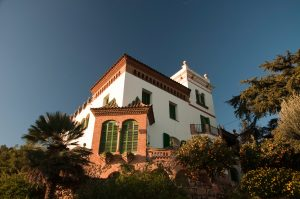 A Spanish villa, the photo taken from a low angle, against a blue sky