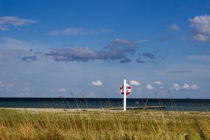 Lifebelt on a pole near the sea
