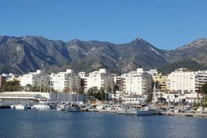 A port near marbella: white high-rises near the water