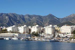 A port near marbella: white high-rises near the water