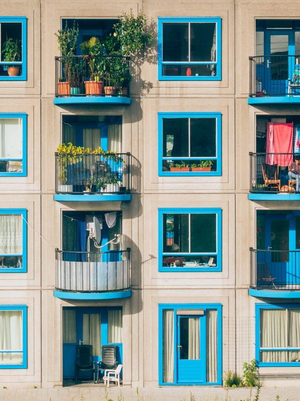 Flats in Amsterdam with balconies painted blue