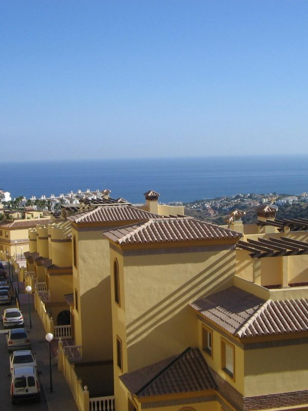 A row of houses in Sitio de Calahonda, with a view towards the sea