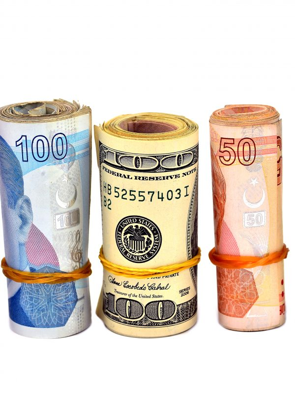 Currencies from different countries lined up in rolls