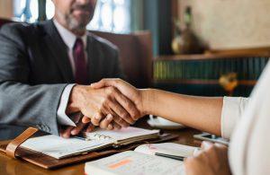 Handshake over desk