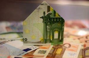 Bank note folded into house shape