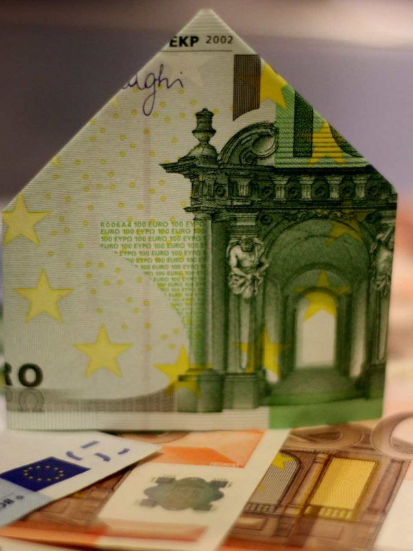 Bank note folded into house shape